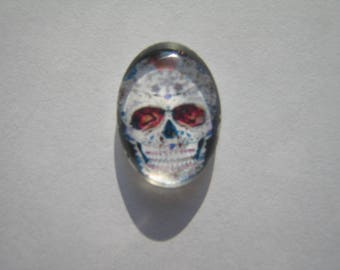 Glass cabochon oval 13 X 18 mm skull image with Brown, white and black