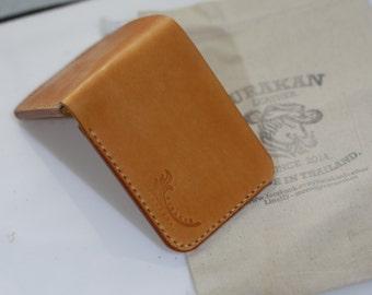 handmade 100% short wallet veg tanned leather.