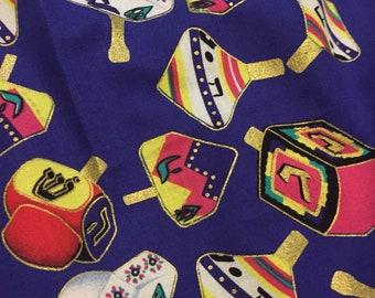"""Judaic Fabric Colorful Dreidels on Blue  Half Yard 18"""" x 44"""""""