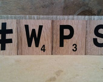 Recycled tongue and groove flooring Scrabble style letter blocks.