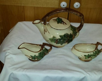 Vintage 1940s McCoy Ivy 3 Piece Tea Set. Teapot has the Lid. Creamer and Sugar.All pieces are perfect. No chips, cracks. Has Crazing.VG Cond