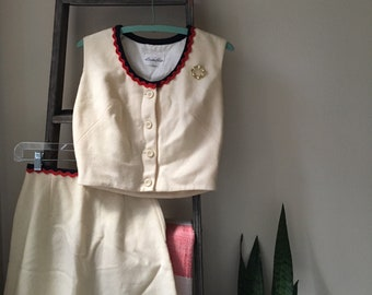 Vintage two-piece cream skirt and shell set, red and blue bric a brac trim, button-up front, size XS