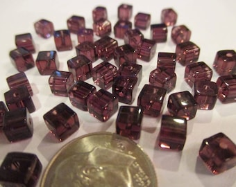 Package of 40 Purple Glass Cube Beads 4mm. Item:BC818749