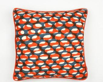 Dappled hand printed linen cushion. Orange grey