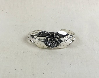 Silver Cuff Bracelet With Leaves and a Flower