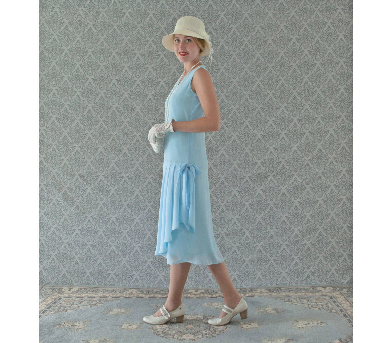 Light blue 1920s-inspired flapper dress with drape and bow
