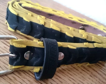 Black and yellow belt made from a recycled bike tire, with eyelets - 3cm wide