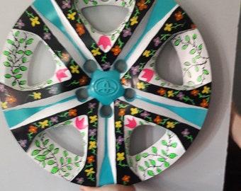 painted hubcap art