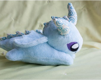 Dragon, stuffed animal, plushie, toy, fantasy creature, snuggle toy, spirals, baby dragon