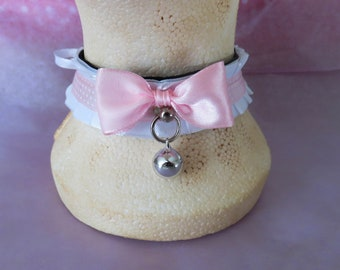 White pleated collar with pink accents