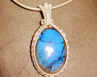 Bright blue, flashy, labradorite, wire wrapped in  fern weave with fine silver.
