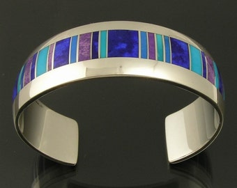 Sterling silver bracelet inlaid with lapis, sugilite, cerrullite and turquoise by Mark Hileman.