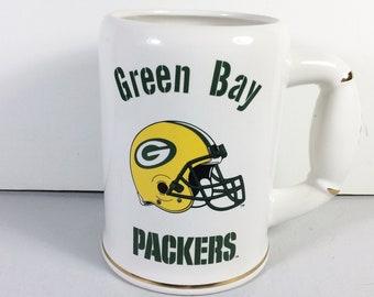 Green Bay Packers ceramic beer stein football handle.