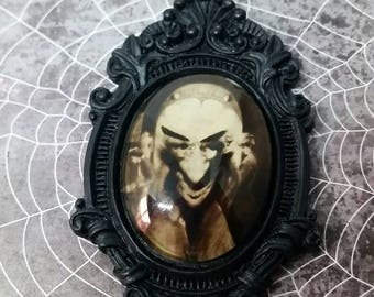 Ornate Necklace with Vintage Illusion Image-Gossip and Satan