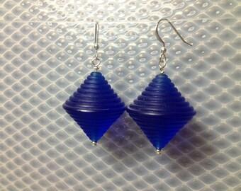 Lantern shaped earrings in transluscent blue.