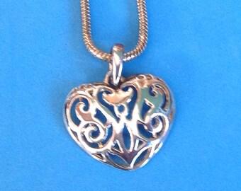 """Vintage - Cut out heart pendant necklace silver tone, 29"""" long."""