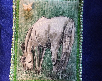 Tiny Art Quilt ATC White Stallion Grazing in a Field with a Butterfly