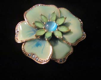 Enamel Brooch. Vintage, pale green brooch with beautiful blue center stone, waves of pale blue on large petals. Trim in silver toned metal