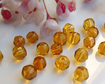 40 beads faceted 5mm yellow Czech glass