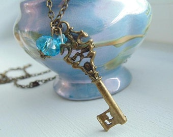 SALE.Bronze Key and Blue Swarovski Crystal. Key Necklace. Pendant Necklace. Long Charm necklace