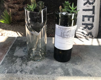 Self watering succulent planters made out of recycled wine bottles