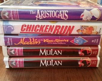 Disney Movie Classics Vhs Tapes / VHS / 80s / 90s / Aristocrats / Chicken Run / Aladdin / Mulan / Cartoons / Animated / Movie / Kid Movies