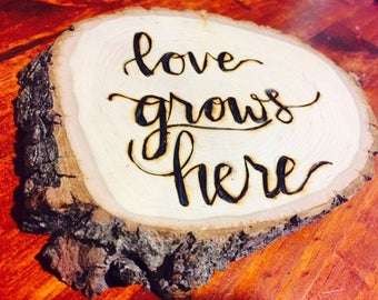 Love Grows Here custom wood burned sign