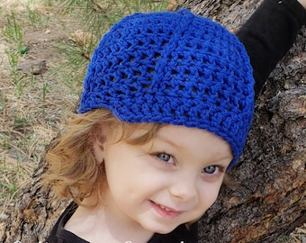 Vibrant blue spiral, brimmed crochet hat that fits toddlers aged 1-3 years!