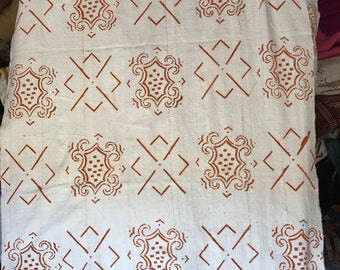 White and orange print Mudcloth