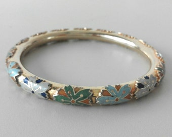Golden bangle with polychrome enamels
