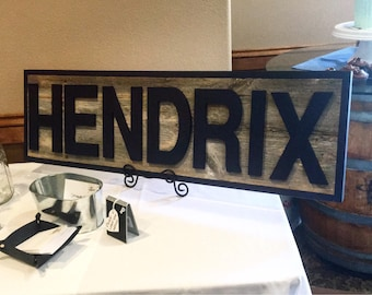 Reclaimed wood name sign.