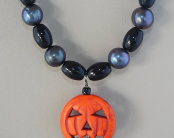 Dark pearls with black accents and Jack-o-lantern pendant