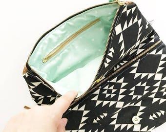 Add an interior zippered pocket