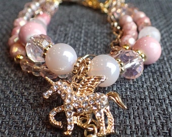 unicorn charm multi strand beaded  bracelet in pink and gold