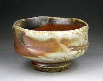 Chawan: WoodFired Stoneware Tea Bowl with Multi-Faceted Design & Carbontrap Glaze