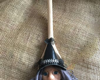 Kitchen witch on wooden spoon