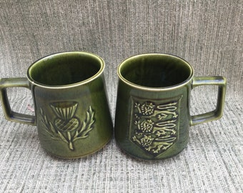 A pair of Holkham Pottery  Mugs