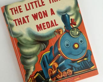 1947 The Little Train That Won A Medal by Darlene Geis - Illustrated by Anton Loeb- A Wonder Book