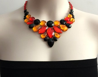 bib tulle necklace. red jet black and orange rhinestone statement necklace