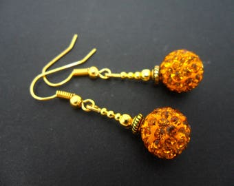 A pair of pretty gold colour shamballa style dangly earrings.