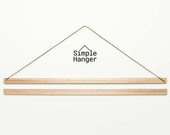 Simple Hanger S1 (600mm* wide) —A lightweight, low profile, magnetic poster and textile hanger.