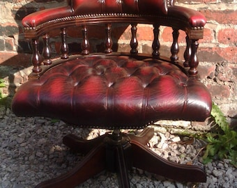 NOW SOLD An elegant Red oxblood buttoned leather captains desk chair