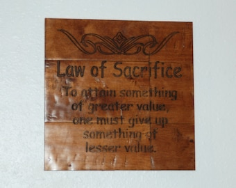 Law of Sacrifice. To attain something of greater value, one must give up something of lesser value. - Plaque 14072