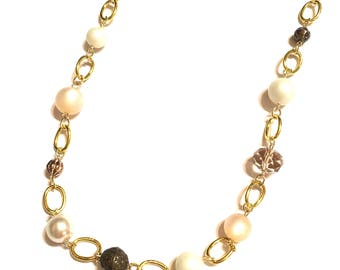 Necklace. Gold. Neutral colors. Long.
