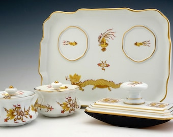 A Meissen Porcelain Desk Set, Post 1938 Comprising: Inkwell, Powder Container, Stamp, Tray Blue Crossed Swords Mark, Impressed Model No. 381