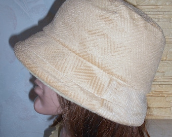 Beige hat of Panama. Wool hat of Panama on fleece. A warm hat of Panama for winter and spring.