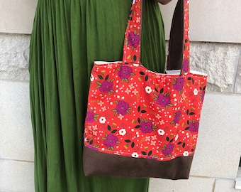 Floral purse with leather straps and bottom Handbag