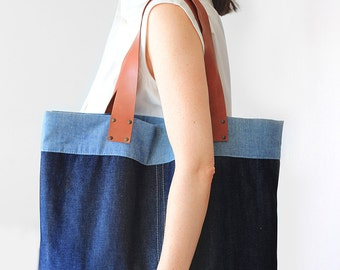 A denim bag with leather straps, A tote bag, side bag