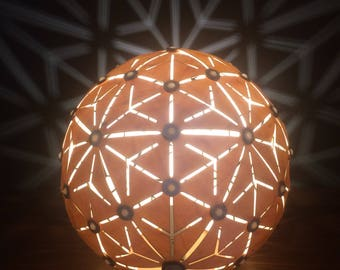 Stunning wooden table lamp, glowing orb, geodesic dome light.