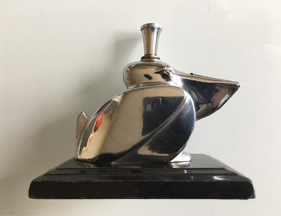 Art Deco Ronson Pelican table lighter on marble base